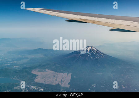 Fuji mountain and plane ving. Photo from the airplane - Stock Photo