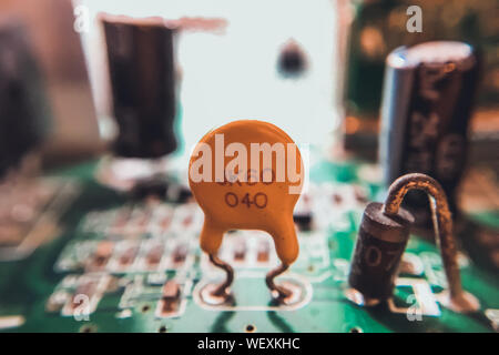 Close-up Of Capacitors And Resistors On Circuit Board - Stock Photo