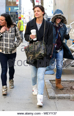 New York, NY - Katie Holmes bares no makeup as she grabs a hot Starbucks coffee during a break on the set of 'Dangerous Liaisons'. Katie made a wardrobe change and slipped into a pair of Saint Laurent high top sneakers. AKM-GSI March 27, 2014 - Stock Photo