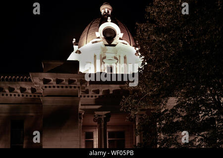 A night time view of the top of the Tupelo City Hall Building with a dome and round windows, with spotlight  in Elvis hometown, Tupelo, MS, USA, - Stock Photo