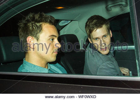 London, UK - Tom Daley and his boyfriend Dustin Lance Black leaving Celebrity Juice at Riverside Studios. Tom was a panel guest on the comedy quiz TV show. AKM-GSI April 1, 2014 - Stock Photo
