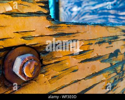Close-up Of Nut And Bolt On Weathered Wood - Stock Photo