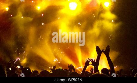 Enthusiastic Fans Cheering At Musical Concert - Stock Photo