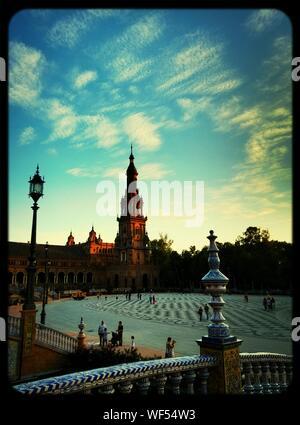 Low Angle View Of Plaza De Espana Against Cloudy Sky - Stock Photo