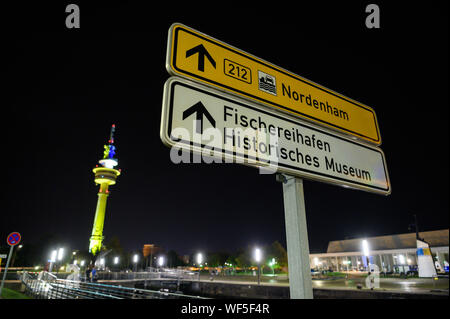 Bremerhaven, Germany. 31st Aug, 2019. 'Fishing Harbor - Historical Museum' is written on a street sign. Credit: Mohssen Assanimoghaddam/dpa/Alamy Live News