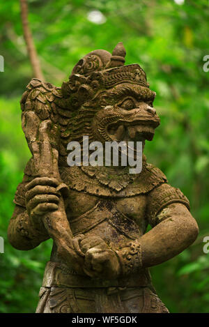 Statues and carvings depicting demons, gods and Balinese mythological deities. - Stock Photo