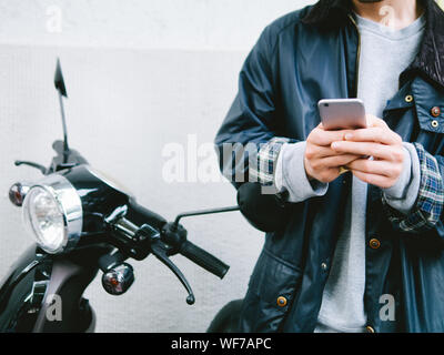 Midsection Of Man Using Mobile Phone While Sitting In Bus - Stock Photo