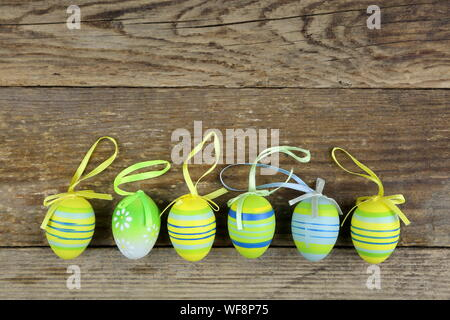 High Angle View Of Colorful Easter Eggs Arranged On Wooden Table - Stock Photo