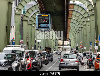 The Wuppertal suspension railway, train of the latest generation #15, downtown, over Kaiserstrasse street, in Wuppertal-Vohwinkel district, - Stock Photo