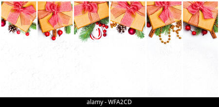 Christmas set of golden Xmas gift. Composition collage with yellow gift, stars, garland, green Xmas fir branch, red holly berries and baubles on white - Stock Photo