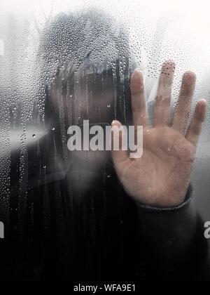 Woman Seen Through Wet Window In Rainy Season - Stock Photo