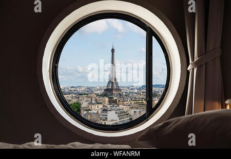Looking through window, Eiffel tower famous landmark in Paris, France - Stock Photo