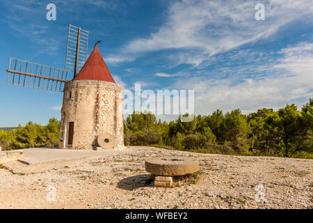 A traditional  stone windmill in Provence, France - Stock Photo