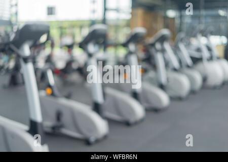 Defocused Image Of Treadmills In Gym - Stock Photo
