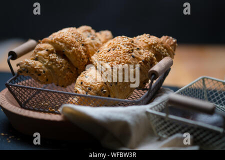 Close-up Of Croissants In Wire Mesh Tray - Stock Photo