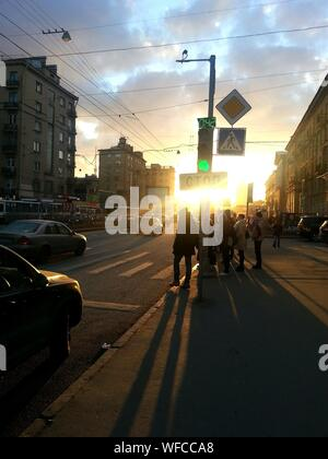 Group Of People Waiting For Traffic Light - Stock Photo