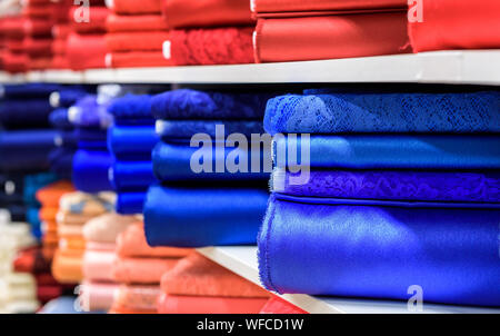 Full Frame Shot Of Multi Colored Rolled Up Fabrics For Sale On Shelves - Stock Photo