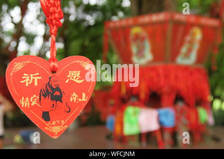 Close-up Of Red Heart Shape Chinese Label For Sale At Market - Stock Photo