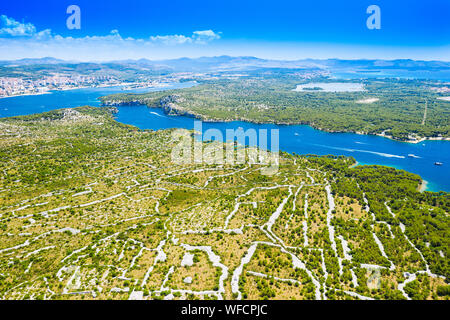 Croatian Adriatic coast, beautiful landscape in Sibenik channel, old agriculture fields in karst, aerial view - Stock Photo