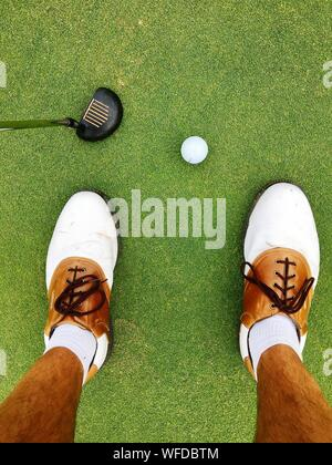 Low Section Of Man Playing Golf On Turf - Stock Photo
