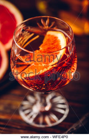 Blood orange whiskey sour cocktail with aged bourbon, blood orange juice, cherry syrup and cinnamon - Stock Photo