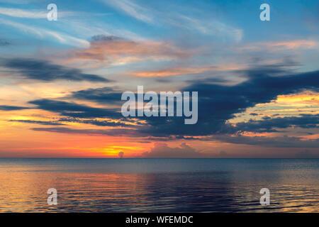 Sunrise by the ocean beach in Key Biscayne, Florida