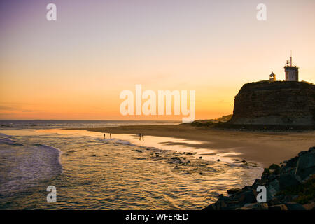 Nobbys Head Break wall with Lighthouse and Beach with Sunset Newcastle New South Wales NSW, Australia - Stock Photo