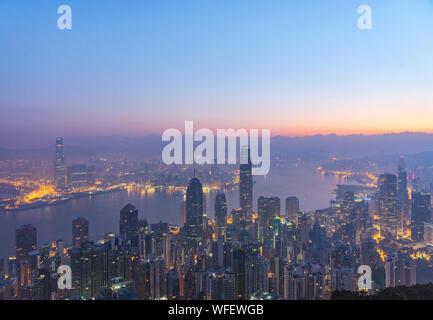 High Angle View Of River Amidst Illuminated City At Dusk - Stock Photo