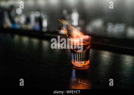 Close-up Of Flaming Shot On Bar Counter - Stock Photo