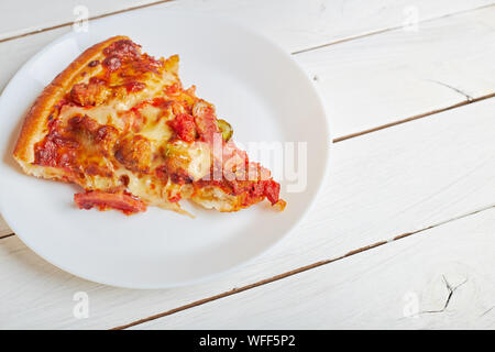 Top view of Italian rustic one slice pizza on white wooden table background concept flat lay food - Stock Photo