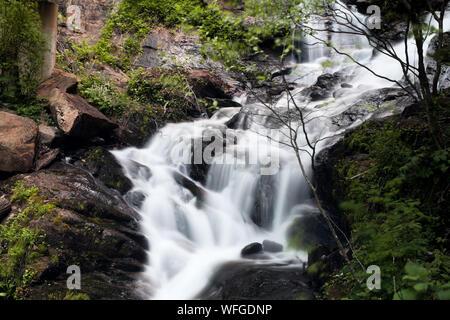 Stream Flowing Through Rocks - Stock Photo