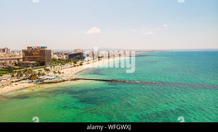 Palma city, Mallorca, Spain - July 03, 2019: People have rest on Palma city beach, aerial drone view. Landscape. Popular summer resort. - Stock Photo