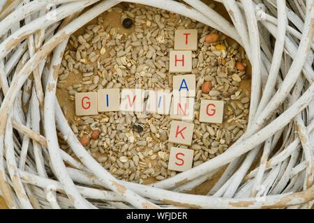 Crossed letters of THANKSGIVING on grains of corn - Stock Photo