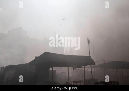 Smoke Emitting In City - Stock Photo