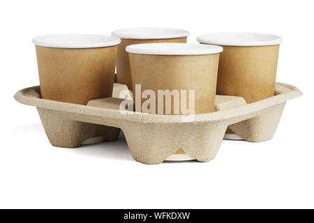 Four Coffee Cups in Disposable Paper Tray on White Background - Stock Photo