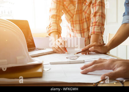Engineer team hands sketching a housing project. - Stock Photo