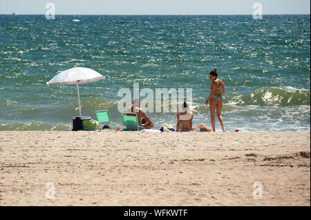 Fort Lauderdale, Florida, USA. 31st Aug, 2019. Bathers at Fort Lauderdale beach enjoy the calm before the storm. Credit: Orit Ben-Ezzer/ZUMA Wire/Alamy Live News - Stock Photo