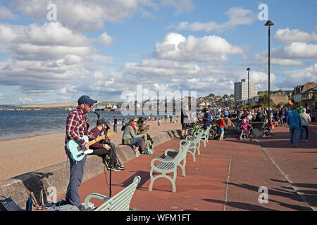 Portobello, Edinburgh, Scotland, UK. 31st August 2019. The Edinburgh Big Beach Busk returned for a tenth time this year, with Portobello beach promenade welcoming hundreds of musicians. The huge busking event was originally arranged as a way of giving a space to Edinburgh buskers who were perhaps squeezed by the Festival. - Stock Photo