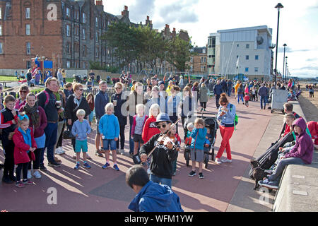 Portobello, Edinburgh, Scotland, UK. 31st August 2019. The Edinburgh Big Beach Busk returned for a tenth time this year, with Portobello beach promenade welcoming hundreds of musicians. The huge busking event was originally arranged as a way of giving a space to Edinburgh buskers who were perhaps squeezed by the Festival. The Violin Boys. - Stock Photo