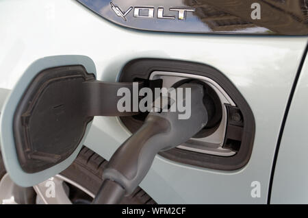 Ajax, Ontario/Canada - August 30 2019: A Chevrolet Volt charges its battery at Elexicon Energy Inc's office on Taunton Rd. in Ajax. - Stock Photo