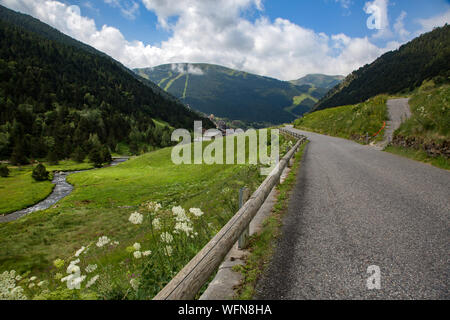 Scenic View Of Road By Mountains Against Sky - Stock Photo