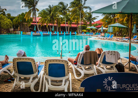 Be Live hotel, Varadero, Cuba - Tourists on beach chairs relaxing around the pool - Stock Photo