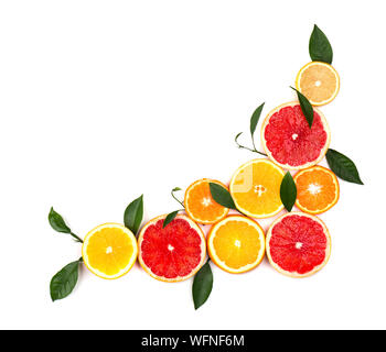 Isolated citrus fruits. Pieces of lemon, lime, pink grapefruit and orange isolated on white background, with clipping path. Top view - Stock Photo
