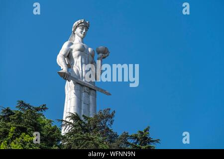 Georgia, Tbilisi, Kartlis Deda monument or Mother of Georgia on the top of the Sololaki hill is the symbol of Tbilisi - Stock Photo