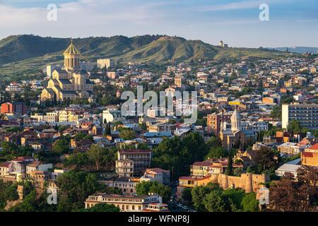 Georgia, Tbilisi, panorama from Narikala fortress, view of Avlabari district and the Holy Trinity Cathedral (or Tsminda Sameba) - Stock Photo