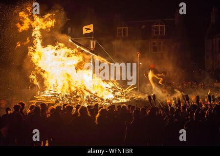 United Kingdom, Scotland, Shetland Islands, Mainland, Lerwick, Up Helly Aa festival, ritual burning down of the viking longship by throwing torches - Stock Photo