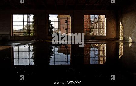 Water Collected In Abandoned Building - Stock Photo