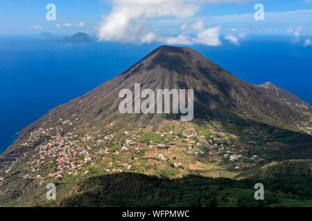 Italy, Sicily, Aeolian Islands, listed as World Heritage by UNESCO, Salina Island, the old volcano Monte dei Porri, the islands of Filicudi and Alicudi in the background (aerial view) - Stock Photo