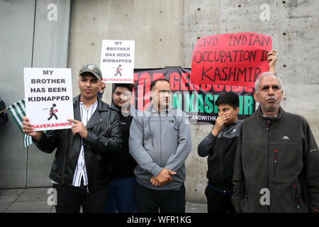Manchester, UK. 31st August, 2019. Hundreds of Kashmir protesters gather in Piccadilly Gardens in Manchester calling for Kashmir freedom. Kashmir is a Himalayan territory which both India and Pakistan say is fully theirs. Each country controls part of the territory.Article 370 of the Indian constitution was removed from the country's only Muslim-majority state and since then hundreds of people have been detained.  With the internet in the country down families in the UK have not been able to find news of their families.  Piccadilly Gardens, Manchester, UK. Credit: Barbara Cook/Alamy Live News - Stock Photo