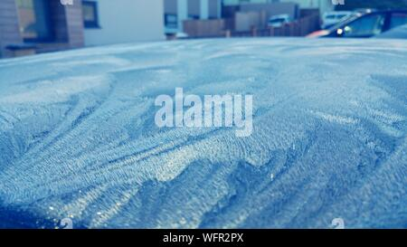 Close-up Of Frost Covered Car In City - Stock Photo